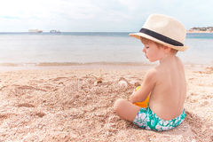 Baby is at the beach. Stock Image