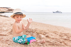 Baby is at the beach. Royalty Free Stock Image