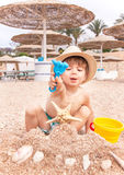 Baby is at the beach. Stock Photo