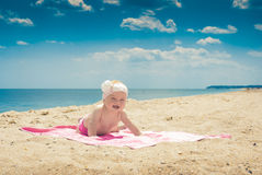 Baby on a beach 3. Cure baby laying on the sunbed at the beach of Black sea Stock Photo