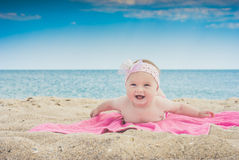 Baby on a beach 2. Cure baby laying on the sunbed at the beach of Black sea Stock Photo