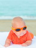 Baby on the beach. Cute baby laying on the sunbed at the beach Stock Photography