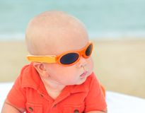 Baby on the beach. Cute baby laying on the sunbed at the beach Stock Photo