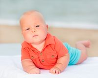 Baby on the beach. Cute baby laying on the sunbed at the beach Royalty Free Stock Photo