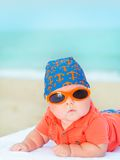 Baby on the beach. Cute baby laying on the sunbed at the beach Stock Images