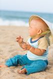 Baby on the beach Stock Photos
