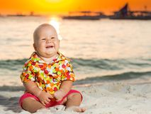 Baby on the beach Stock Image
