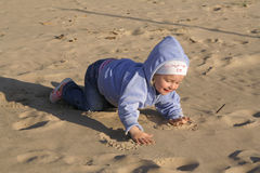 Baby on beach sand Stock Photography