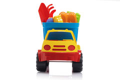 Baby beach sand toys and colorful plastic truck isolated Stock Images