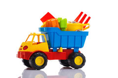 Baby beach sand toys and colorful plastic truck isolated Stock Photo