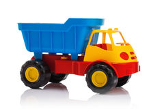 Baby beach toys. Plastic car or truck isolated on white backgrou Royalty Free Stock Photo