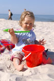 Baby and beach3. Baby girl on the beach and blue sky royalty free stock photography