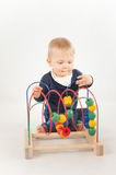 Baby With Bead Toy Royalty Free Stock Images
