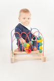 Baby With Bead Toy. On white Stock Photography