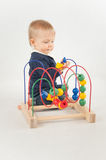 Baby With Bead Toy. On white Stock Images