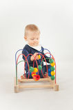 Baby With Bead Toy. On white Stock Photos