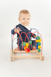 Baby With Bead Toy. On white Royalty Free Stock Photography