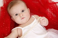 Baby with beads Royalty Free Stock Photo
