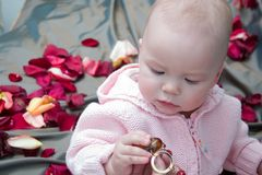 Baby with beads Royalty Free Stock Photos