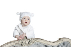 Baby in beanie with pom-poms. On a white background Stock Photo