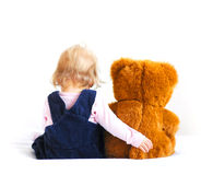 Baby and bear. Little baby girl and teddy bear royalty free stock images