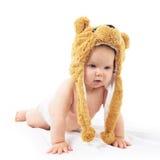 Baby in bear cap. Cute baby in bear cap in white background stock photo