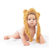 Baby in bear cap. Cute baby in bear cap in white background royalty free stock photos