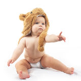 Baby in bear cap. Cute baby in bear cap in white background royalty free stock image