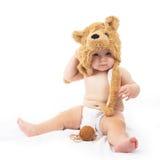 Baby in bear cap. Cute baby in bear cap in white background stock image