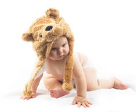 Baby in bear cap. Cute baby in bear cap in white background stock photography