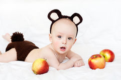 Baby in a bear costume Stock Image