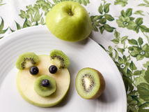 Baby bear face made of fruit, fun dessert for children Royalty Free Stock Images