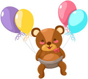 Baby bear flying with balloon Stock Image