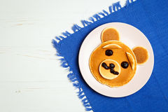 Baby bear on a pink plate Royalty Free Stock Images