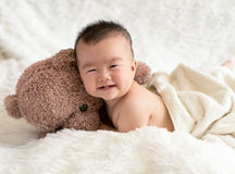 Baby with bear toy Stock Photography