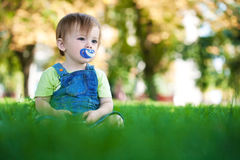 Baby in a beautiful summer park Royalty Free Stock Image