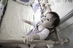 Baby in bed Stock Images