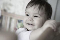 Baby in bed Royalty Free Stock Photo