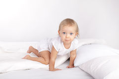 Baby in bed Stock Photo