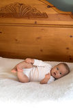 Baby on Bed Stock Images