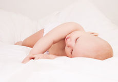 Baby in bed Royalty Free Stock Image