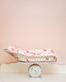 Baby bed. Pictre of a tiny baby bed on top of a scale Stock Photo