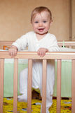 Baby in a bed. Portrait of a happy baby in a bed Stock Images