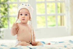 Baby on the bed. Beautiful cute baby on the bed Royalty Free Stock Image