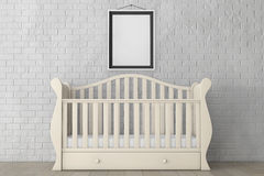Baby Bed with Blank Photo Frame. 3d rendering. Baby Bed with Blank Photo Frame in front of Brick Wall. 3d rendering Royalty Free Stock Photo