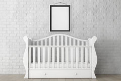 Baby Bed with Blank Photo Frame. 3d rendering. Baby Bed with Blank Photo Frame in front of Brick Wall. 3d rendering Stock Photography