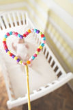 Baby in a bed in frame of heart shape. Out of focus baby Royalty Free Stock Image