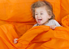 Baby in bed Stock Photos