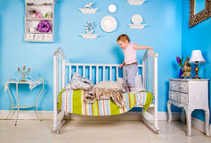 Baby on the bed. Baby playing on bed in the room Royalty Free Stock Image