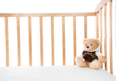 Baby bed with teddy bear for child Stock Photo